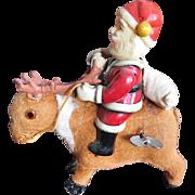 Vintage Windup Christmas Toy Santa Riding Reindeer