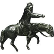Miniature Sterling silver figurine of a man riding a horse