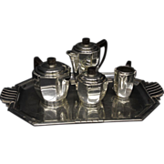 Art Deco Silver plated tea set consisting of tea pot, coffee pot, covered sugar, creamer, and tray