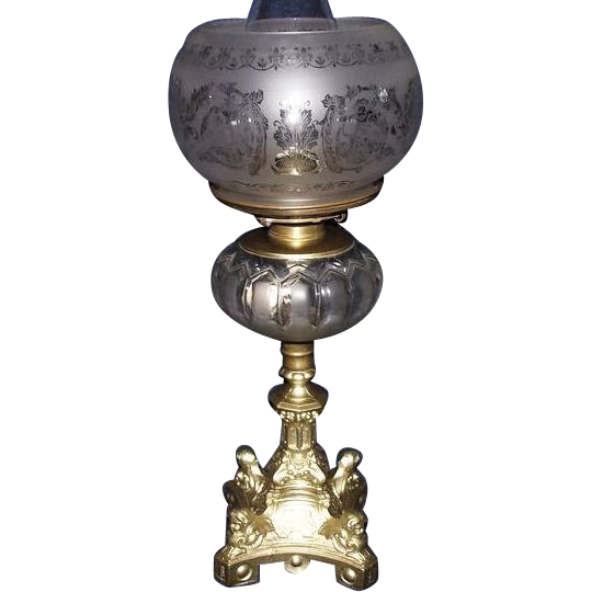 Semi-Frosted Glass Fount on a Four Cherub Headed Gothic Baroque Dietz Catalog 1860's Base, complete with an Acid Etched Gothic Shade with Cherubs & Griffins !!!