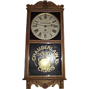 """Red Light Saloon, Dodge City,KS."" Clock in a Golden Oak Case Advertiser with a ""Chamberlain Durham Cigars"" marked lower Glass Tablet !!! Circa 1915."