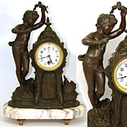 "Large Antique French Figural Mantel Clock, Cherub or Putti: ""L' Heure Militaire, 57 rue du Faubourg du Temple, Paris"""