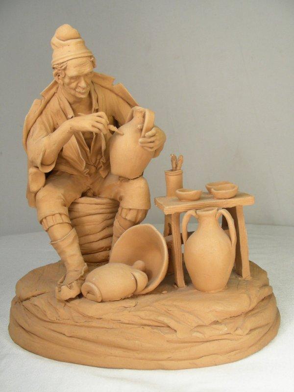 Vintage Clay Figure of A Potter signed R Verrella