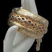 Gold Toned Repousse Bracelet Braided Trim
