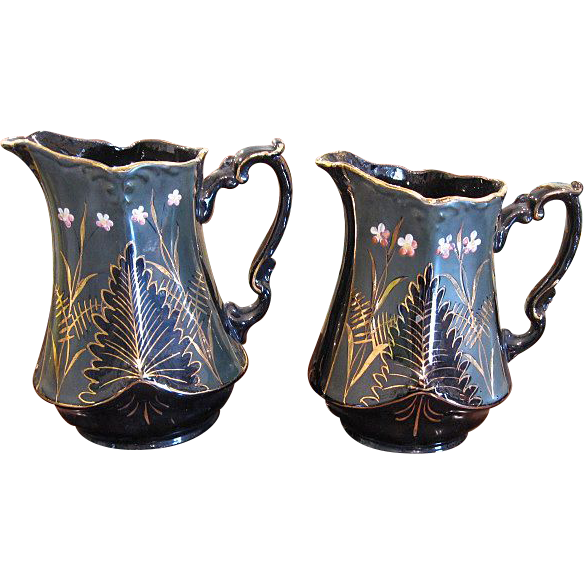 Set of 2 Jackfield Pottery Pitchers with Gilt Trim and Enamel