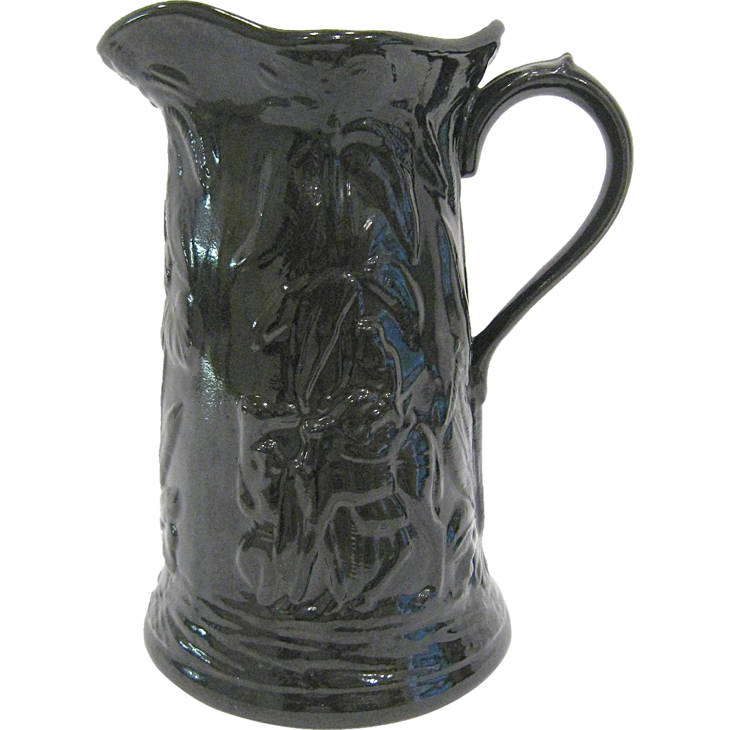 Continental Pottery Relief Moulded Jug