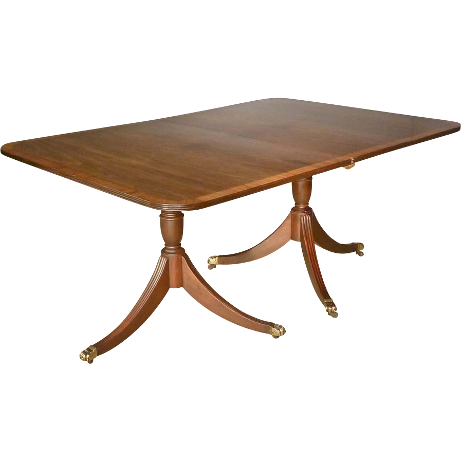 double pedestal dining table with banded inlaid top from