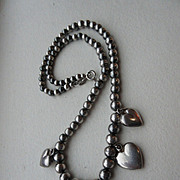 Vintage Sterling Graduated Beaded And  Puffy Heart Necklace On Silver Chain