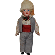 All Bisque Boy Doll wearing his Original Cltohes