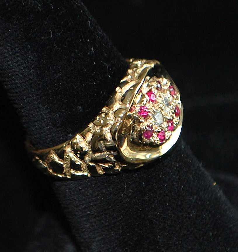 14k s ruby and nugget style ring from