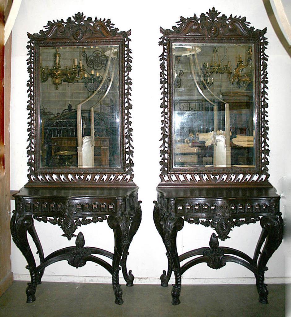 Highly Carved Pair of Mirrored Consoles