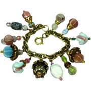 Napier Gold tone Large Art Glass Rhinestones Dangle Charm Bracelet