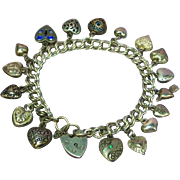 Victorian and 1940s Petite English Sterling Silver Mini Puffy 17 Hearts Charm Bracelet