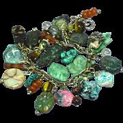 Vintage  Multiple Colored Tumbled Carved Genuine Gemstones Sterling Charm Bracelet