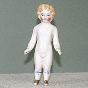 "3 3/4"" Blond Frozen Charlotte with Blue Garters"