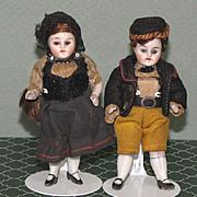 "Pair 3 1/2"" Kling All Bisque Dollhouse Dolls in Original Costumes"
