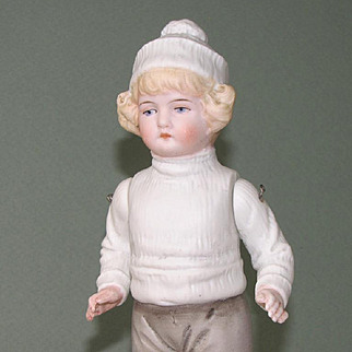 "7 1/2"" Hertwig Early All Bisque Boy in Winter Attire"