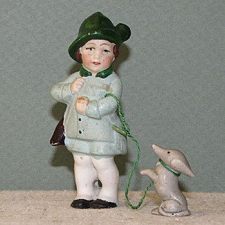 "3 1/8"" Hertwig Hunter Boy with his Ferocious Dachshund on a Leash"