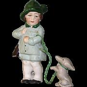 """3 1/8"""" Hertwig Hunter Boy with his Ferocious Dachshund on a Leash"""