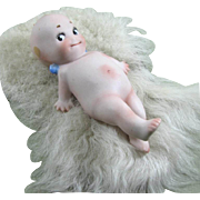 "4 1/2"" Kicking Kewpie on Fur Rug ~ So Cute!"