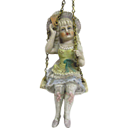 Bisque Swinger Girl Doll With Fan