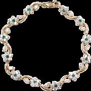 """Vintage 14k Gold Faux Diamond and Faux Emerald Flower Bracelet 7 1/4"""""""