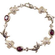 Vintage 14k Gold Garnet Dolphin and Sea Turtle Bracelet ~ 7 3/8""