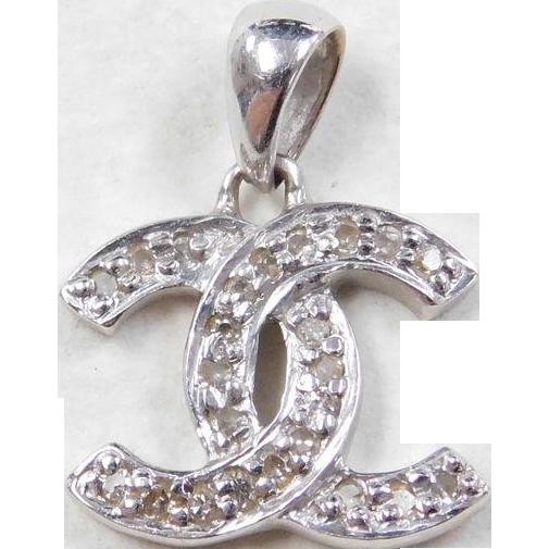 Vintage 14k white gold chanel logo diamond pendant arnold jewelers vintage 14k white gold chanel logo diamond pendant arnold jewelers ruby lane aloadofball Choice Image