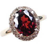 Vintage 14k Gold Two-Tone Garnet and Champagne Diamond Halo Ring