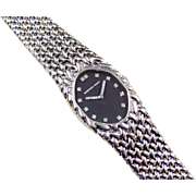 1970's Audemars Piguet Ladies Watch 18k White Gold Woven Bracelet with Black Face & Diamond Number Markers and Hands
