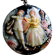 Painted Celluloid Mirrored Pendant of a Romantic Couple