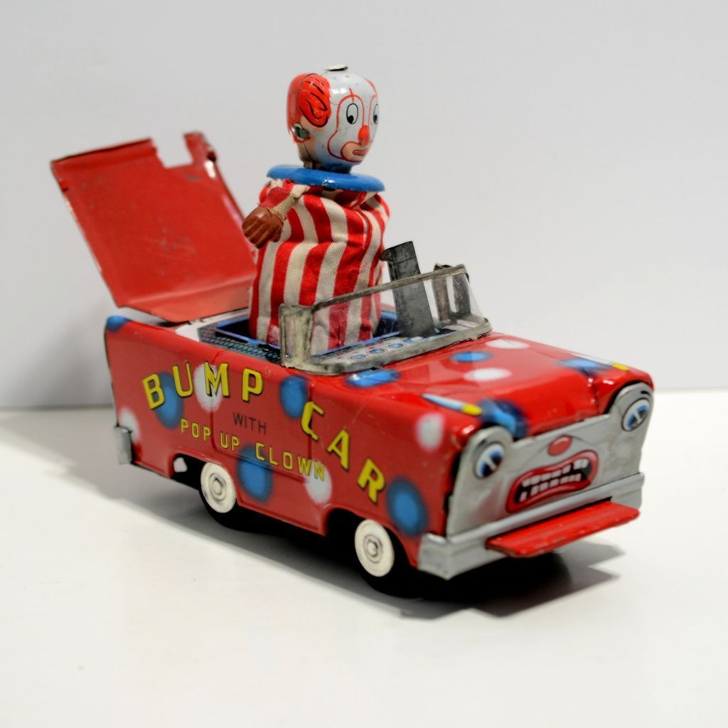 Pop Up Vehicles : Wakasuto friction tin bump car with pop up clown from