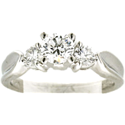 Modern Estate Platinum Three Stone Engagement Ring