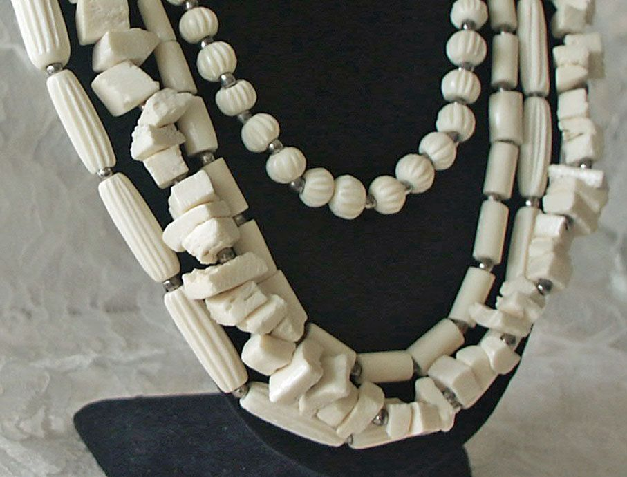 Long four strand Bone Necklace Multishaped Beads