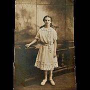 Postcard Girl in Polka Dot Dress and Braids