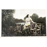 RPPC Postcard Hand Tinted Pretty Girl on Log Chair