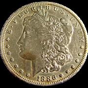 Three silver dollars. 1886 O, 1921, 1923 S