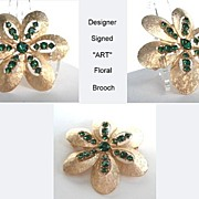 Vintage Designer Signed ART Emerald Rhinestone Floral Brooch Pin Brushed Satin Gold Tone