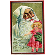 1911 Embossed Postcard Santa In White Holding Doll