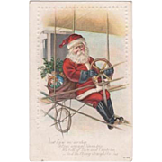 Santa Flying His Bi-Plane Embossed Postcard