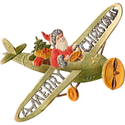 Embossed German Die-Cut Santa In Airplane