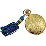 BG356 Vintage Estee Lauder Gold Compact Powder with Mirror and Royal Blue Tassel Pocket Watch Style
