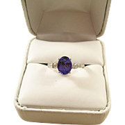 Exquisite Tanzanite Solitaire Ring set in 14ct White gold with Diamonds - Size 7