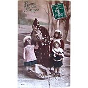 Christmas RPPC, Santa, 3 Children, Bisque Doll, Bonne Année, Hand Tinted French Real Photo Postcard Postmarked 1912