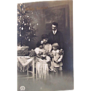 Belgian Christmas Card, Family Portrait With Doll and Decorated Tree, Vroolijt Kerstfeest, Real Photo Postcard, Postmarked 1917