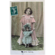 Tinted French Real Photo Postcard, Little Girl in Pink Walking Her Big Doll Dressed in Blue, Little Mother, Circa 1910s