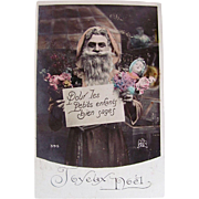 Hand Tinted French Real Photo Postcard, Santa in Peach-colored Robe, Doll and Flowers, Circa 1910s