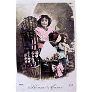 Happy New Year, Little Girl with Dolls and Toys, Tinted French Real Photo Postcard, Circa 1910s