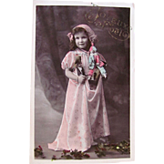 Gorgeous Tinted French Real Photo Postcard, Beautiful Little Girl Holding Dolls and Toys, Merry Christmas,  Dated 1911