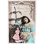 New Years Greetings, Little Girl, Doll and Tree, Tinted French Real Photo Postcard, Postmarked 1908